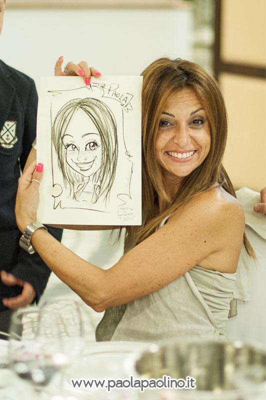 Ospite mostra la caricatura